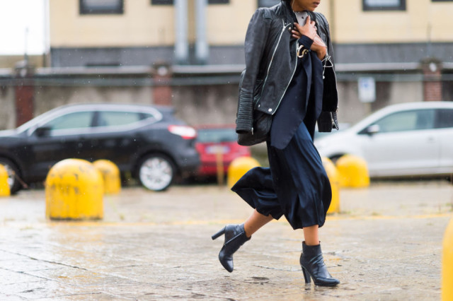 black maxi skirt in winter milan fashion week street style elle.com - booties mid skirt moto jacket black and anavy fall layers rain