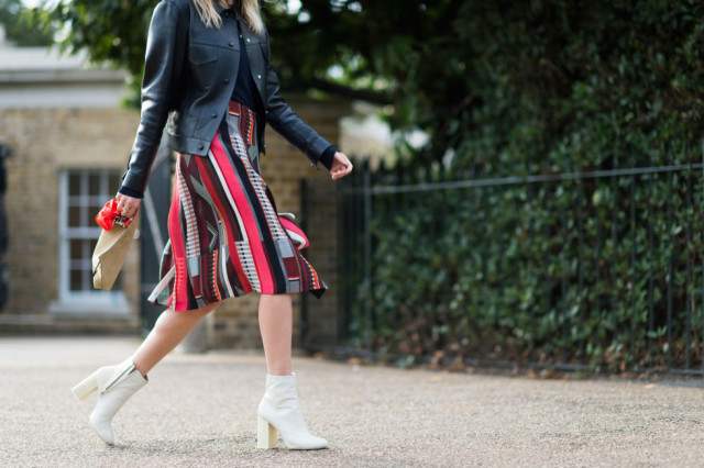 mod booties-white boots-patchwork prints-fall prints-fall skirts-midi knee skirt-leather jacket-via-lfw street styleelle.com