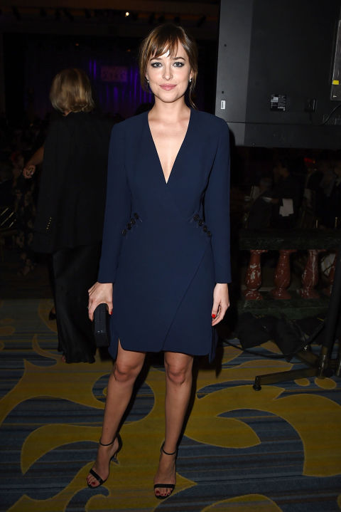 navy-dress-cocktail dress fall wedding-wrap dress-fall party office party-simple black sandals-dakota johnson-via getty