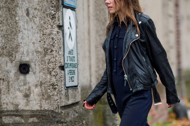 navy jumpsuit-black leather moto jacket-black and navy-fall otufits-milan fashion week street style-via elle.com