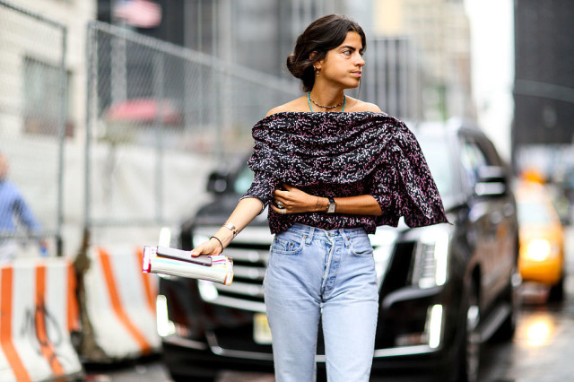 nyfw-off the shoulder-high waisted jeans - going out top - draped - clutch- layered boho necklaces - mom jeans-blogger style - leandra medine-via-popsugar