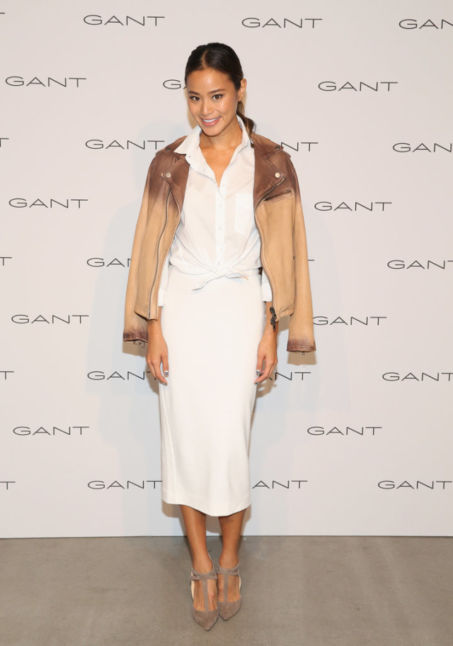 white skirts in fall winter, jacket on shoulder, knotted shirt, white button up shirt, jamie chung, celeb style, winter outfit, holiday outfit, winter work outfit, nyfw-white pencil skirt - knotted white oxford shirt - men's oxford - tan leather moto jacket - summer to fall transitional dressing - mary jane flats- fall work otufit - via getty