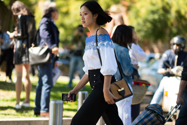 off the shoulder shirt-high waisted pants-fall going out outfit-milan fashion week street style-via elle.com