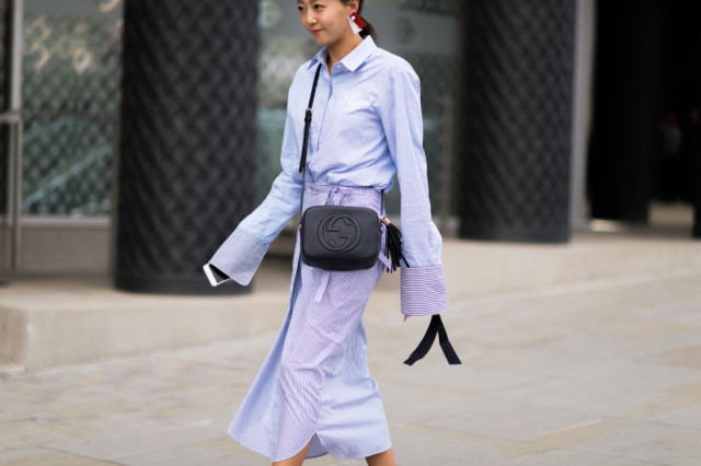 shirtdress-wrap skirt-major cuffs-fall work-tassle earrings-tassle purse-bell sleeves-lfw street style-elle.com