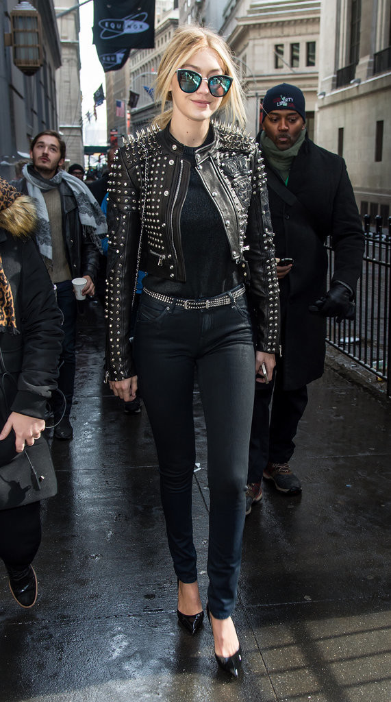 studded black leather jacket-black skinnies-belt-heels-black tee-all black edgy-model off duty style-gigi hadid-fall outfits-going out night out-via getty