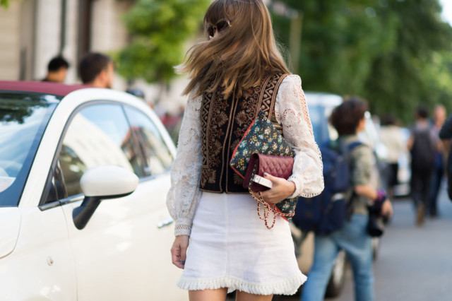 white firnge skirt-lace top-victorian top embroidered gold vest-milan fashion week street style-via elle.com