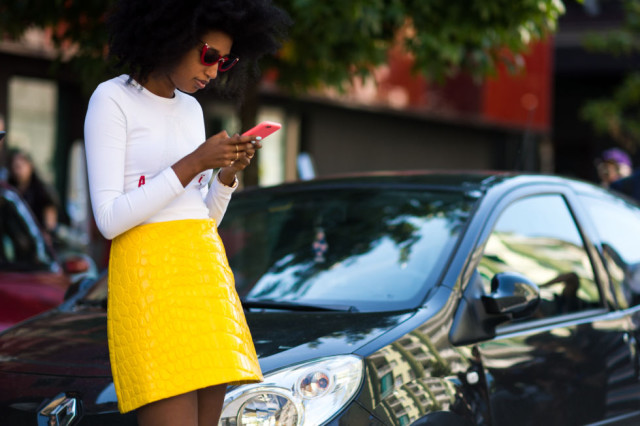 yellow textured mini skirt python-white tee - fall outfits -milan fashion week street style-via elle.com