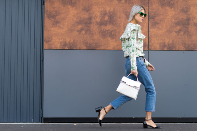 cropped high waisted mom jeans vicctorian blouse ruffle victorian cropped mom jeans ankle strap block ehesl white purse paris fashion week street style elle