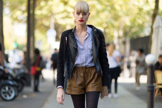 how to wear brown and black, brown leather shorts, shorts and tights, black moto jacket, striped oxford shirt, model off duty style