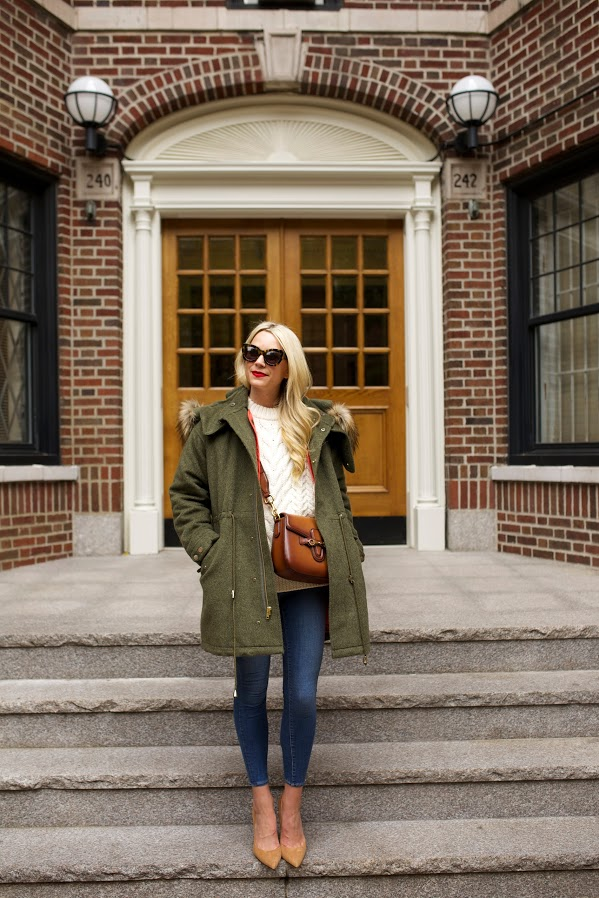 atlantic pacific fisherman sweater fall weekend outfit, army green fur trim parka skinny jeans saddle bag pumps