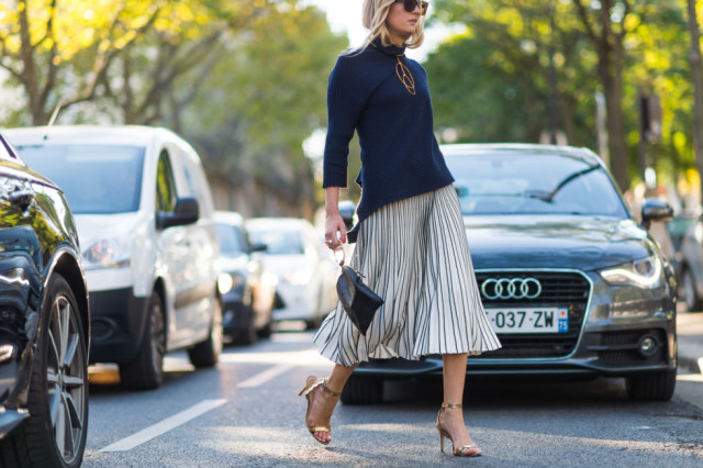 pleated midi skirt navy wrap top funnel neck top gold sandals paris fashion week street style fall outfits ell