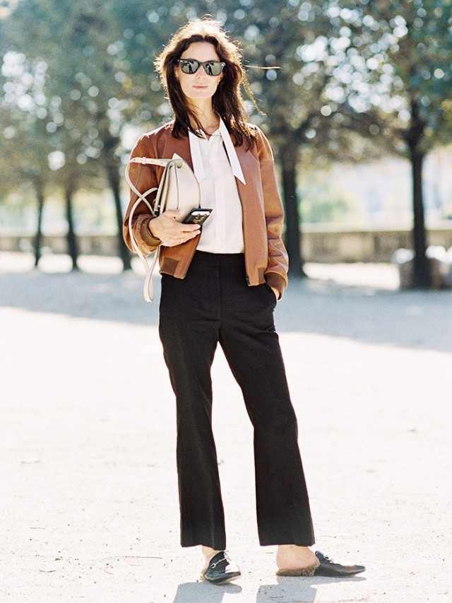 baseball jacket black trouser pants fur gucci slides white tie neck blouse fall neutrals work outfits via