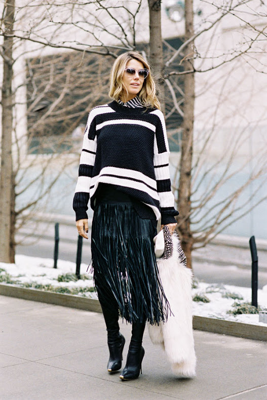 fashion and style black and white fringe skirt black and white striped sweater knee high boots fall outfit going out holiday party work via vanessa jackman