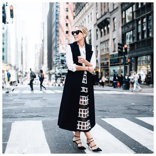 fall work outfit black and white black long vest sleeveless jacket windowpane midi skirt sheer white oxford shirt via damselindior instagram