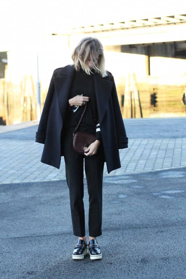 fall work outfit cropped black pants platform loafers creepers black pea coat jacket on sholuders burgundy bag via the fashion eaters