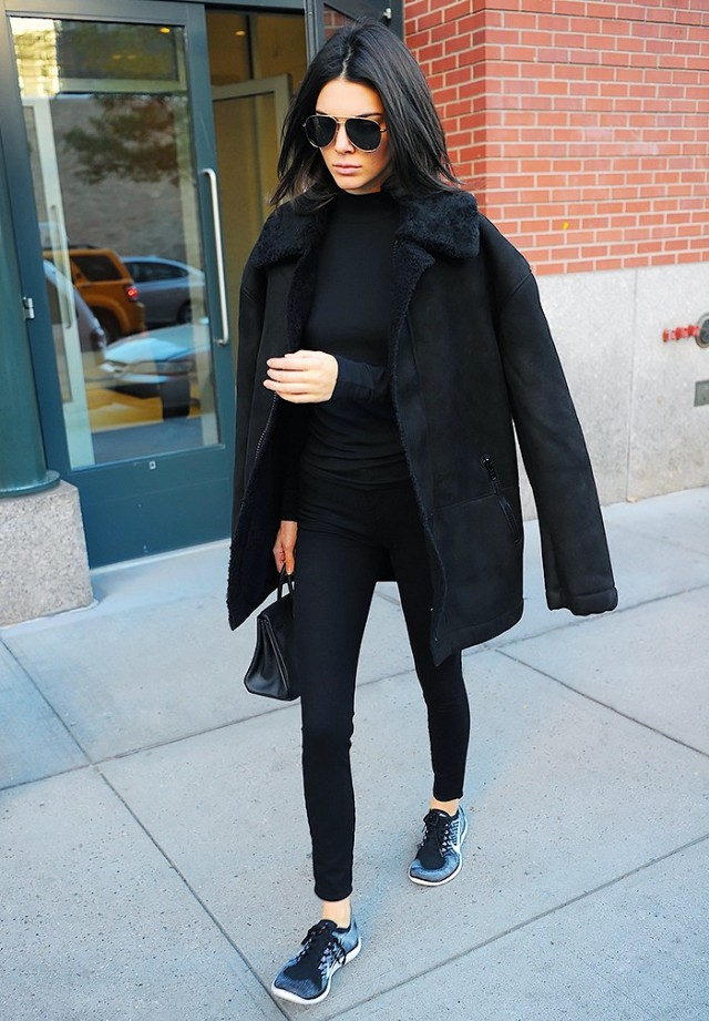 shearling jacket all black black skinnies sneakers gym shoes kendall jenner model off duty jacket on shoulders weekend work fall