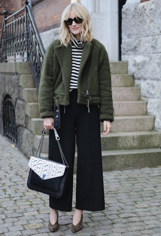 outfit ideas: culottes and turtleneck sweaters, striped turtleneck sweater emerald green furry moto jacket black culottes blame it on fashion