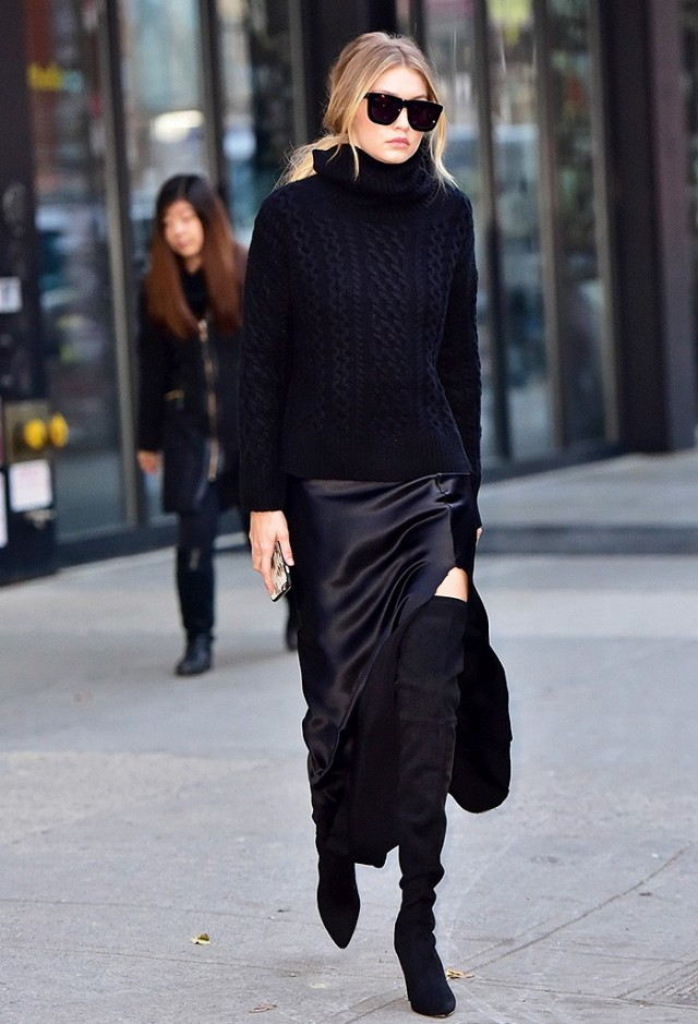 all black, winter work outfit, turtleneck sweater, asymmetrical skirt, holiday party outfit, over the knee boots, gigi hadid