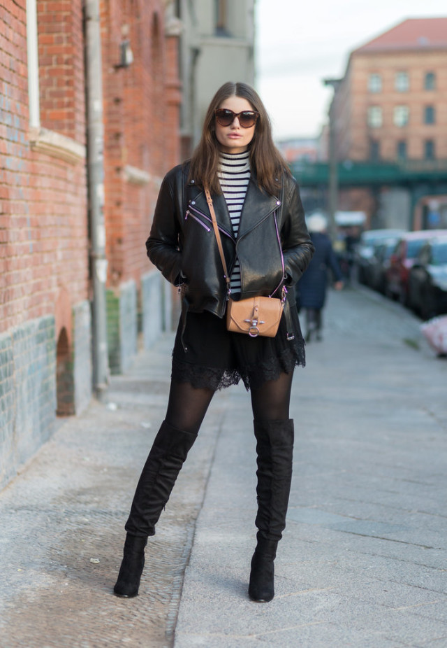 black and white black tights black lace mini skirt black and white striped turtleneck over the knee boots black leather moto jacket mini bag black and white fall going out night out date night outfit