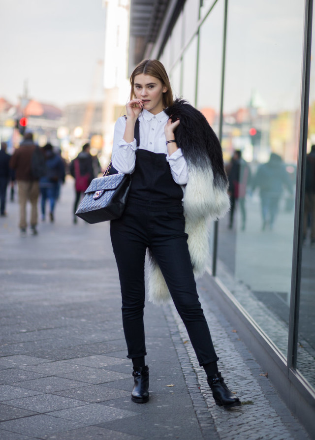 black overalls white button up shirt peter pan collar black and white shaggy fur coat colored fur statement jacket black and white fall outfit fall work weekends ankle booties and socks off duty model style