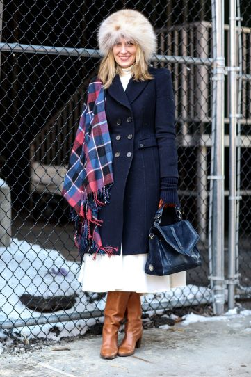 christmas outfit-holiday outfit-what to wear to christmas party-what to wear to a holiday party-white skirt in winter-tan boots-midi skirt-navy pea coat-plaid scarf-fur hat-