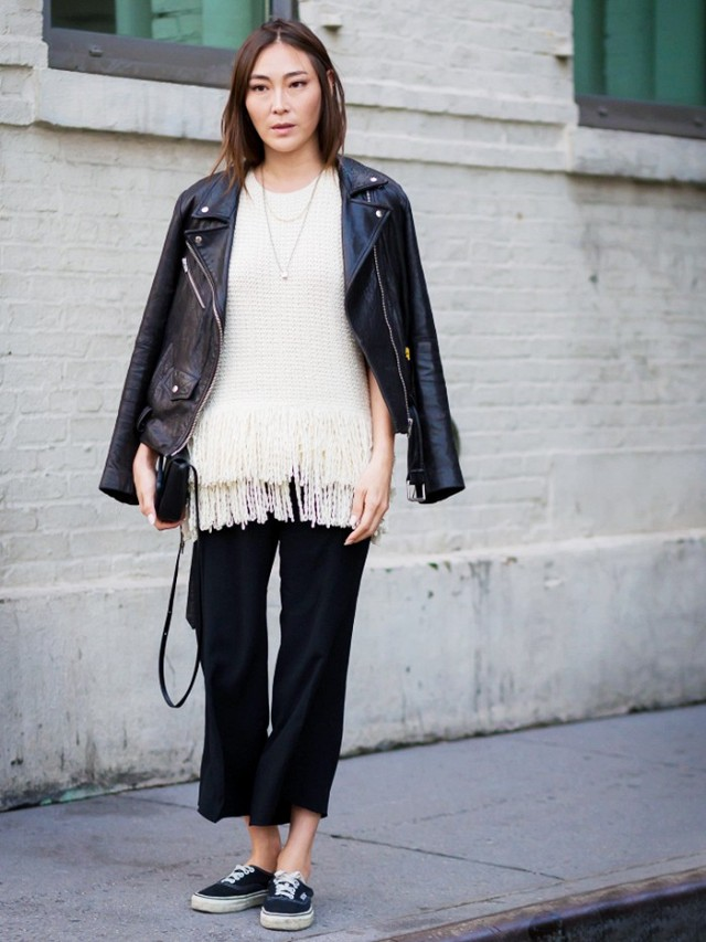 fringe sweater-black and white-cropped black pants, black sneakers black leather moto jacket fall work outfit via style du monde