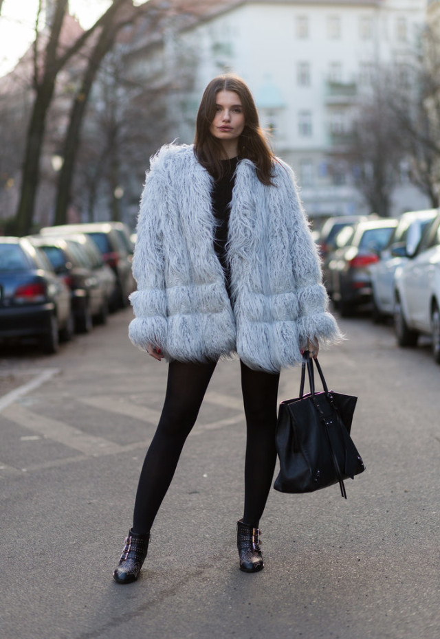 shaggy fur coat white colored fur coat motorcycle booties black skinnies leggings model off duty style