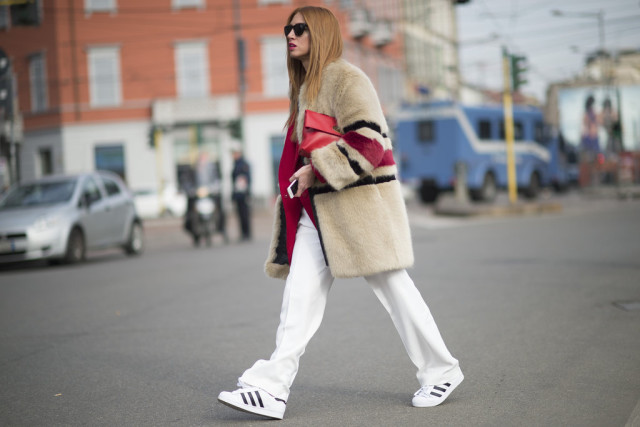 winter whites white wide leg pants adidas sneakers red blazer fur coat striped colored fur coat winter outfit winter work outfit red clutch street style
