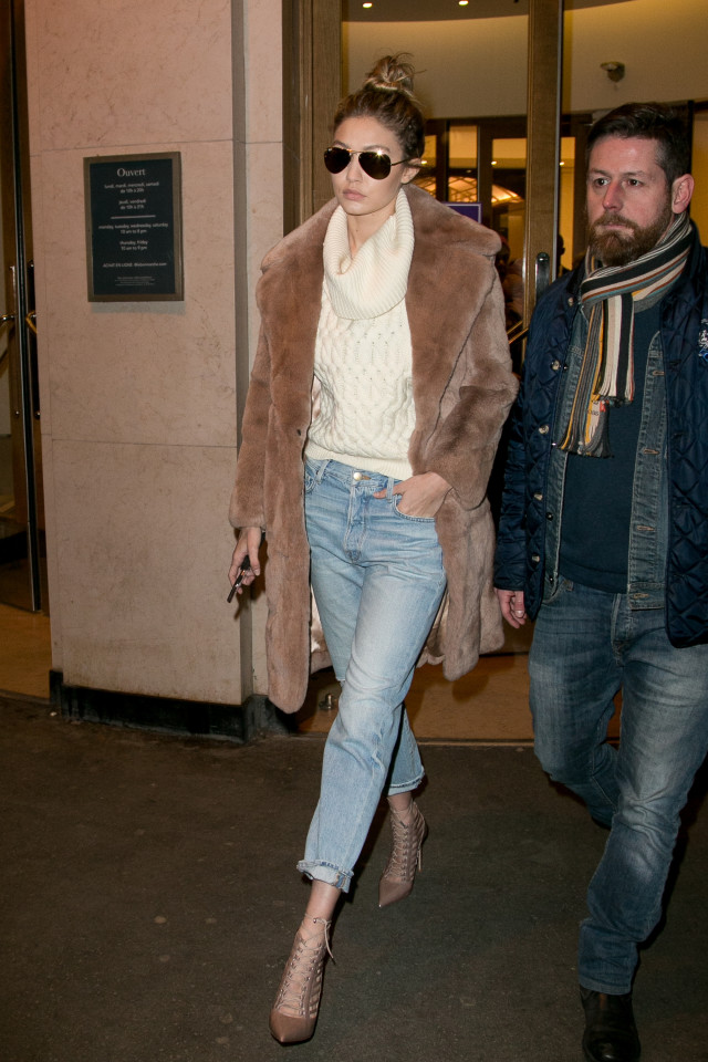 gigi hadid paris couture fashion week, cropped jeans, turtleneck sweater, fur coat, cropped jeans and boots