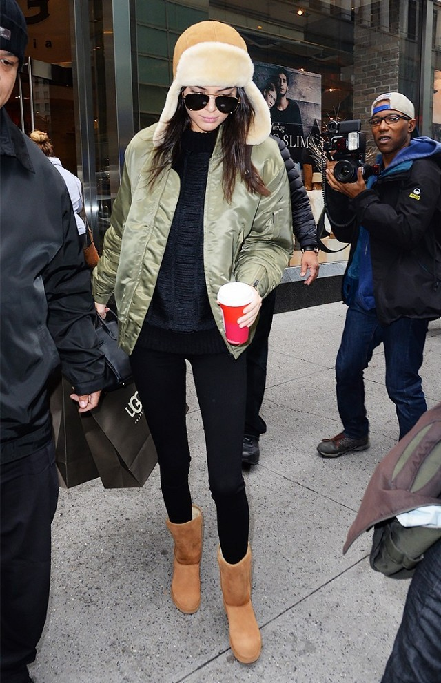 what to wear this weekend, what to wear for a night out in winter black leggings-weekend outfit-uggs-army green baseball jacket-shearling trapper hat-kendall jenner-www
