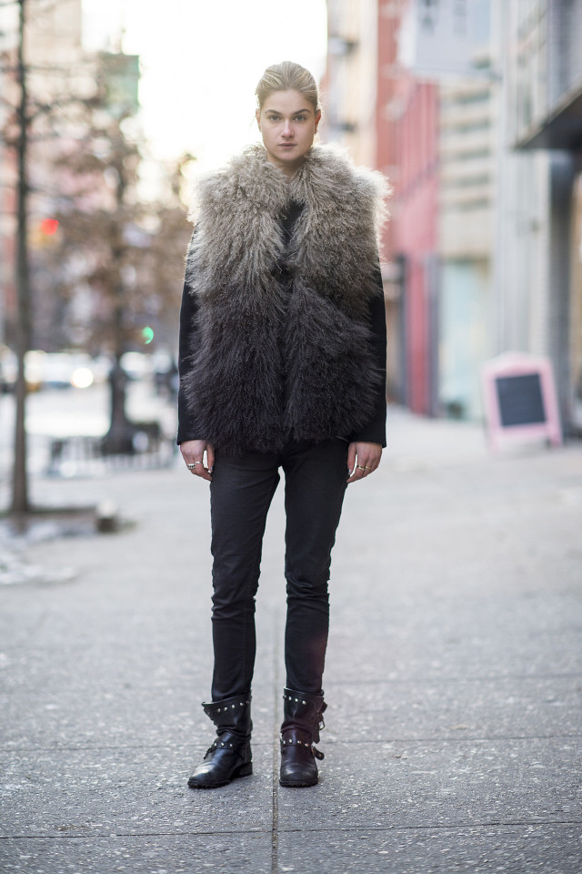 black skinnies-black moto boots-studded boots-furry vest-fur vest-model off duty style-all black-black and white-winter style-what to wear when its freezing outside-snow outfit-