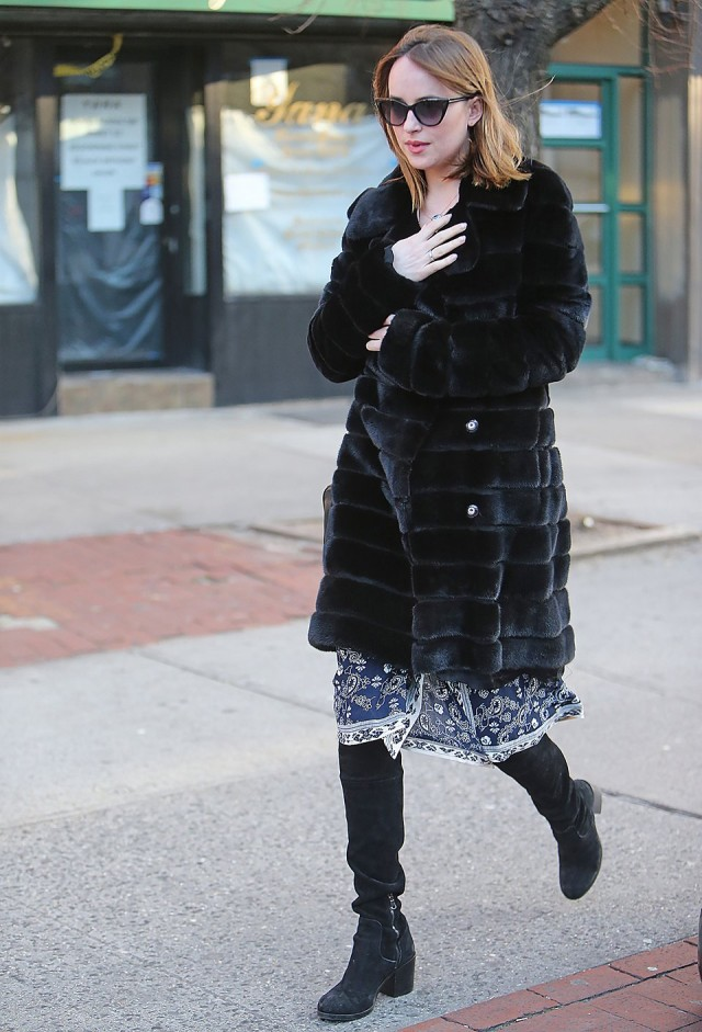 dakota jhonson-black fur coat-knee boots-printed dress-boho-summer dresses in winter-going out-night out-party-