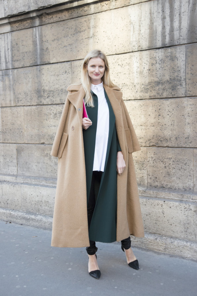 emerald green apnts suit-white tunic shirt-camel coat-candice lake-paris couture fashion week-getty