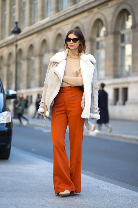 what to wear when it's freezing out, shearling coat, turtleneck, orange flare pants, wide leg pants, 70s