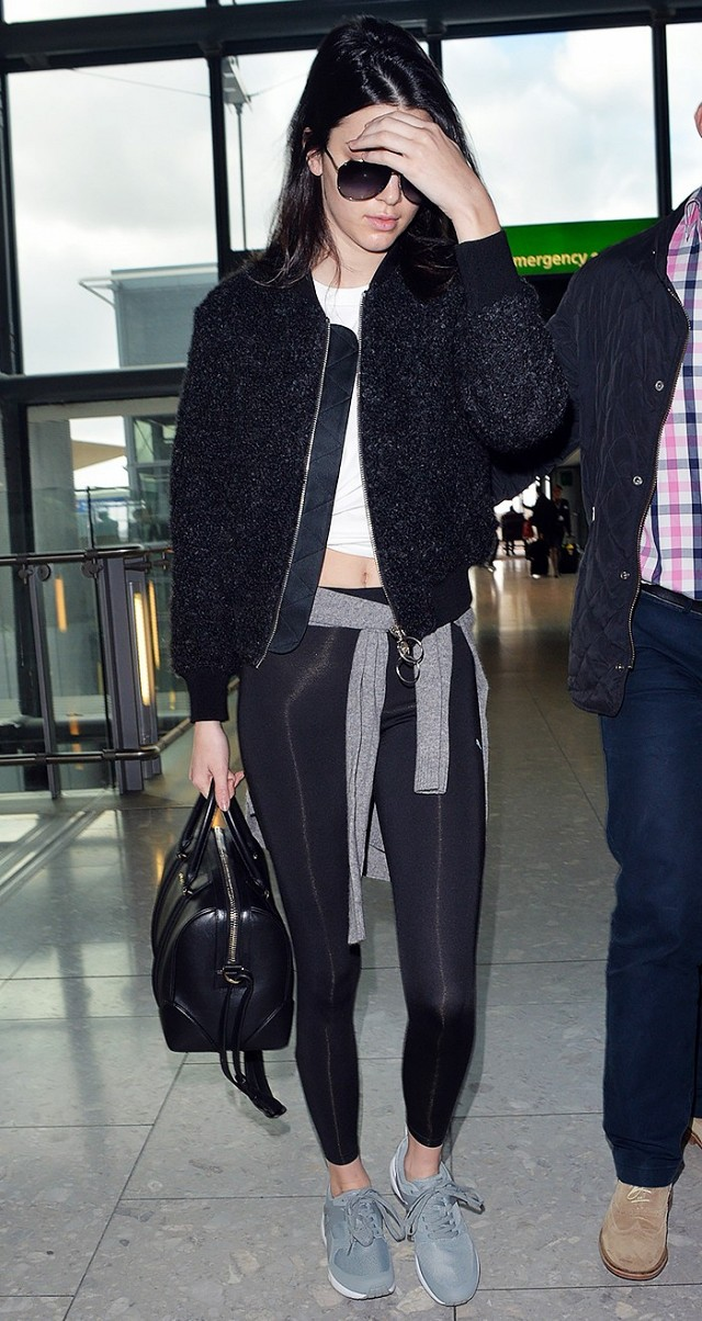 leggings-celeb workout clothes-crop top-sneakers-baseball jacket-airport-kendall jenner-black and white-weekend outfit-weekend brunch-after workout outfit-kendall jenner-www