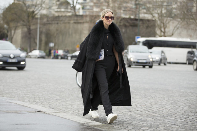 menswear-tomboy-black and white-white sneakers-black trouser pants-fur trim coat-paris couture fashion week-getty