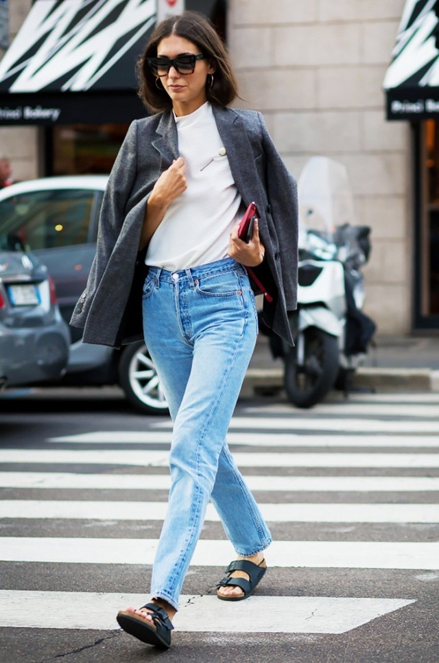 mom jeans-high waisted mom jeans-mockneck turtleneck-grey blazer jacket-jacket on shoulders-pin-brooch-birks-birkenstocks-diletta bonaiuti-