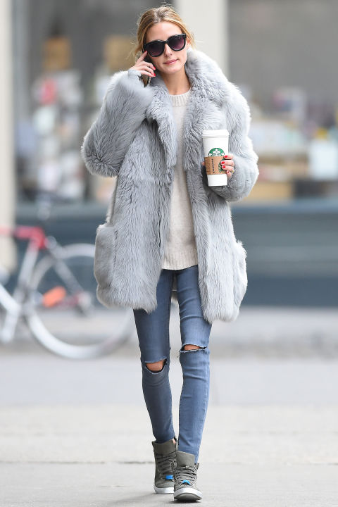 olivia palermo-grey fur coat-what to wear when its freezing-high tops-sweater-ripped jeans-skinny jeans-hbz