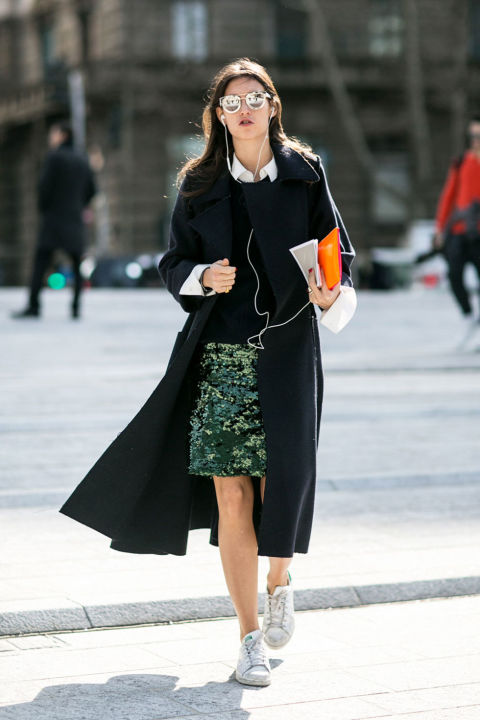 adidas sneakers-white sneakers-emerald green sequined skirt-sweater over collared shirt-cuffs-black coat-model off duty style-milan fashion week street style-cosmo