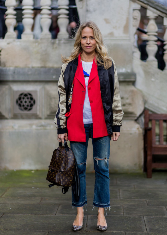 baseball jacket-cropped flares-frayed denim-sweatshirt-graphic sweatshirt-red blazer-baseball jacket-varsity jacket-louis vuitton backpack-printed heels-animal print heels-lfw street style-psuk-getty