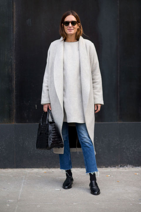 cropped jeans-frayed denim jeans-tunic sweater-grey coat-loafers-tights and jeans-winter outfits-what to wear when its freezing-nyfw 2016 street style-hbz