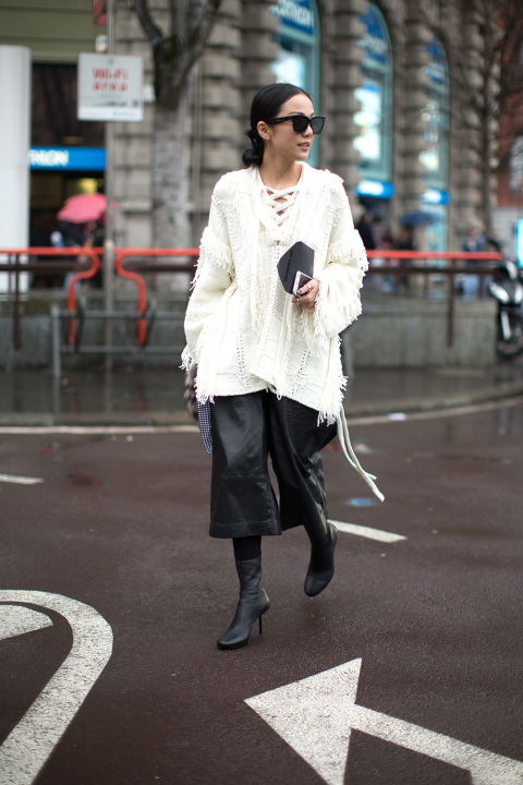 cropped pants and booties-leather culottes-frayed sweater-lace up sweater-milan fashion week street style-hbz