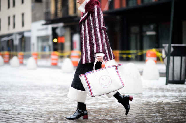 cropped pants and booties-olorblock pants-colored heel booties-tights and pants-turtleneck-smiley face bag-striped coat-statement coat-colorblock coat-nyfw street style 2016 elle