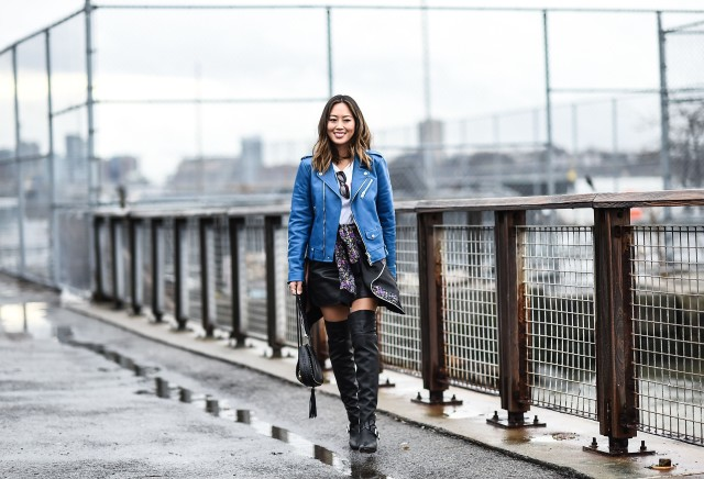 denim jacket in winter-over the knee thigh high boots-shirt around waist aimee song-nyfw street style-getty