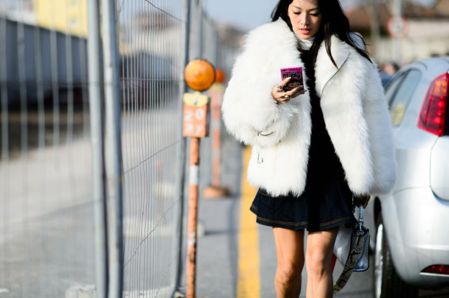 dress over turtleneck black and white-white fur coat-furry coat-mfw street style-elle