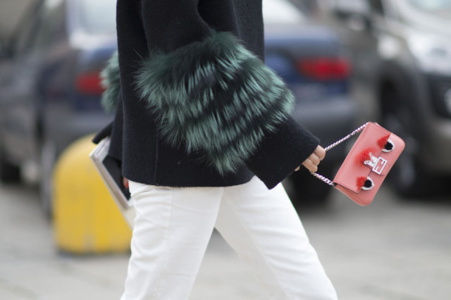 fur sleeves-white jeans-fendi mini bag-milan fashion week street style-cosmo