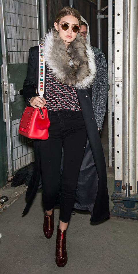 gigi hadid work outfit-cropped pants and booties-rinted top fur scarf-printed booties-mc