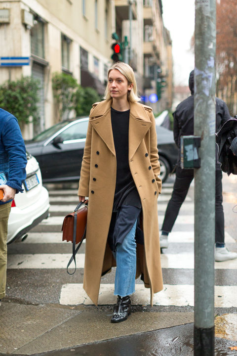milan fashion week-dress over pants-frayed denim-blakc and navy-tunic-camel coat-milan fashion week street style-hbz