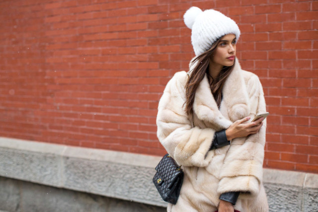 model off duty style-double coats-moto jacket-fur coat-beanie-furry pomp pom hat-chanel bag-winter outfits-nyfw street style 2016-hbz