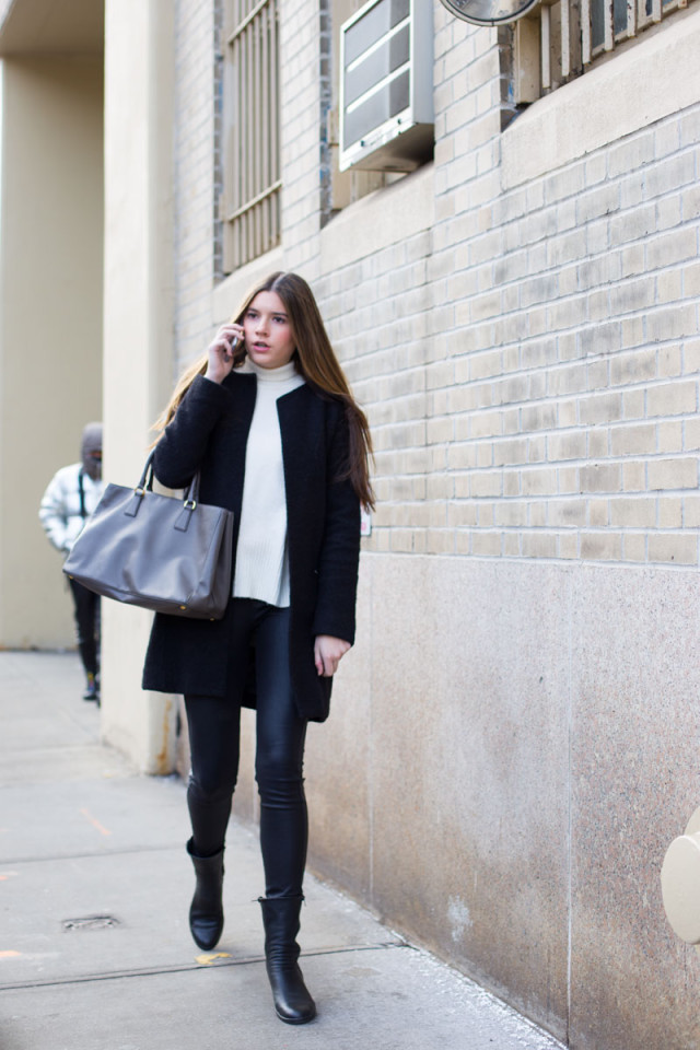 modle off duty style-black skinnies-leather skinnies-black moto boots-mockneck turtleneck black and white black coat--weekend winter outfit